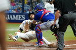 Toronto Blue Jays catcher Alejandro Kirk (30) tags out Tampa Bay Rays' Kevin Kiermaier trying to score during the sixth inning of a baseball game Monday, Sept. 20, 2021, in St. Petersburg, Fla. (AP Photo/Chris O'Meara)