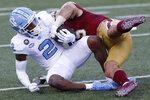 Boston College linebacker Isaiah McDuffie tackles North Carolina wide receiver Dyami Brown (2) during the first half of an NCAA college football game, Saturday, Oct. 3, 2020, in Boston. (AP Photo/Michael Dwyer)