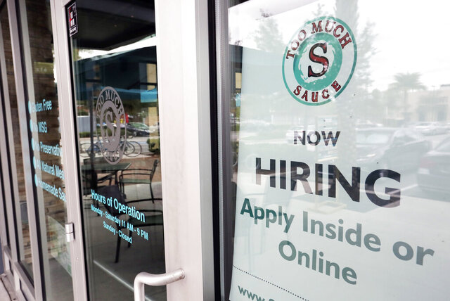 FILE - In this Nov. 4, 2019, file photo a job posting is displayed near the entrance outside a restaurant in Orlando, Fla. Two reports last week show that small business hiring still lags behind the strong job growth reported at larger companies, and that owners are unlikely to increase their staffs significantly in 2020. (AP Photo/John Raoux, File)