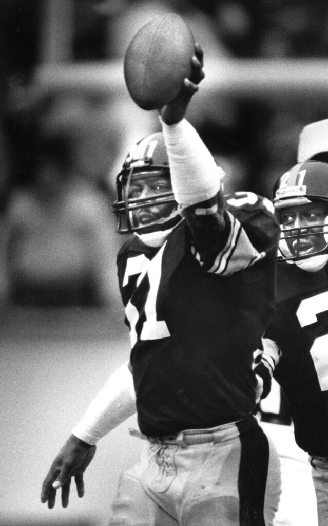 """FILE - In this Dec. 7, 1986, file photo, Pittsburgh Steelers Donnie Shell holds up his 50th intercepted football pass in the third quarter of an NFL football game against the Detroit Lions in Pittsburgh. The hard-hitting cornerback won four Super Bowls during his 14 years in the NFL and next month will become the fifth — and most unlikely — member of the """"Steel Curtain"""" defense to be enshrined in Canton. (Pittsburgh Post-Gazette via AP, File)"""