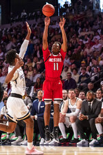 North Carolina State guard Markell Johnson (11) shoots over Georgia Tech forward Khalid Moore (12) in the first half of an NCAA college basketball game Saturday, Jan. 25, 2020, in Atlanta. (AP Photo/Danny Karnik)
