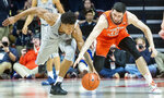 Penn State forward Lamar Stevens, left, and Illinois forward Giorgi Bezhanishvili (15) reach for the ball  during the second half of an NCAA college basketball game in Champaign, Ill., Saturday, Feb. 23, 2019.(AP Photo/Robin Scholz)