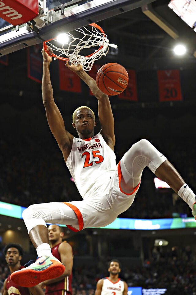 Virginia forward Mamadi Diakite (25) dunks against Boston College during an NCAA college basketball game Wednesday, Feb. 19, 2020, in Charlottesville, Va. (Erin Edgerton/The Daily Progress via AP)