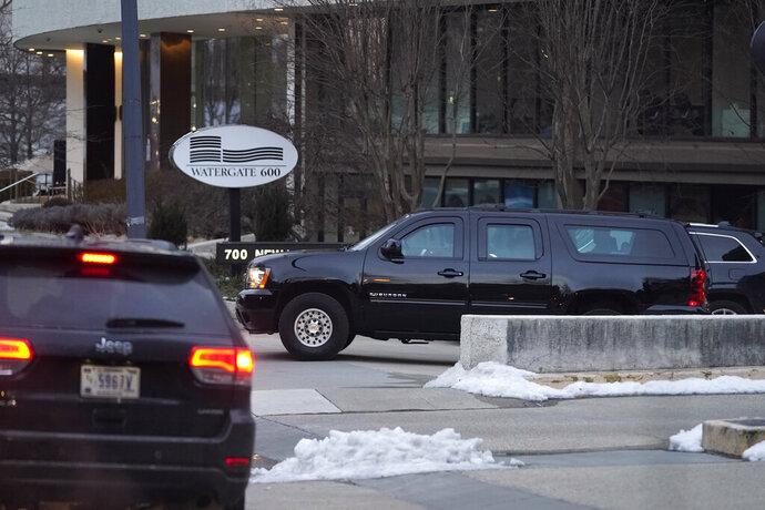 President Joe Biden's motorcade departs the Watergate complex after Biden made a stop to visit with former Sen. Bob Dole, Saturday, Feb. 20, 2021, in Washington. (AP Photo/Patrick Semansky)
