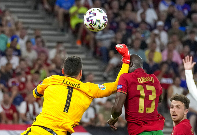 France's goalkeeper Hugo Lloris, left, collides with Portugal's Danilo Pereira during the Euro 2020 soccer championship group F match between Portugal and France at the Puskas Arena, Budapest, Hungary, Wednesday, June 23, 2021. (AP Photo/Darko Bandic,Pool)