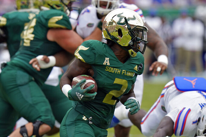 South Florida running back Darrian Felix (2) runs against Florida during the first half of an NCAA college football game Saturday, Sept. 11, 2021, in Tampa, Fla. (AP Photo/Chris O'Meara)