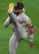 San Diego Padres shortstop Fernando Tatis Jr. warms up before a baseball game against the Colorado Rockies, Monday, Aug. 31, 2020, in Denver. (AP Photo/David Zalubowski)