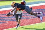 National Team wide receiver Frank Darby of Arizona State (84) leaps for a touchdown against National Team defensive back Camryn Bynum of California (24) during practice for the NCAA Senior Bowl college football game in Mobile, Ala., Thursday, Jan. 28, 2021. (AP Photo/Matthew Hinton)