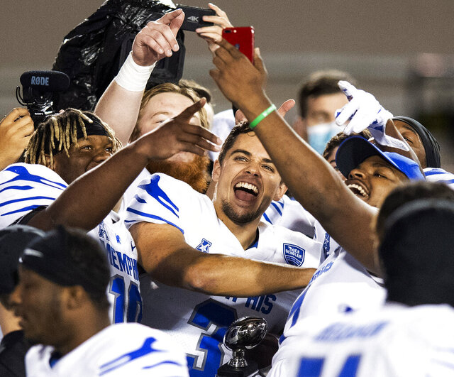 Memphis quarterback Brady White (3) celebrates with teammates after defeating Florida Atlantic in the Montgomery Bowl NCAA college football game, Wednesday, Dec. 23, 2020, in Montgomery, Ala. (Mickey Welsh/The Montgomery Advertiser via AP)