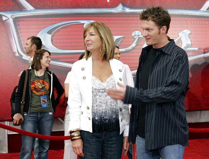 "FILE - In this May 26, 2006, file photo, NASCAR driver Dale Earnhardt Jr., right, and his mother Brenda Jackson, front left, arrive for the premiere of the Disney/Pixar animated film ""Cars"" at Lowe's Motor Speedway in Concord, N.C. Jackson, a longtime employee at JR Motorsports, has died following a battle with cancer. She was 65. The team announced her death Monday, April 22, 2019. (AP Photo/Chuck Burton, File)"