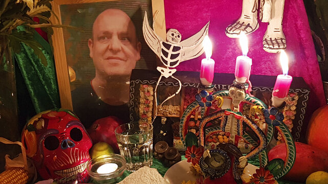 This Nov. 16, 2019 photo shows an altar made by mortician and death cafe host Angela Craig-Fournes in honor of Death Cafe founder Jon Underwood, who died in 2017. (Angela Craig-Fournes via AP)