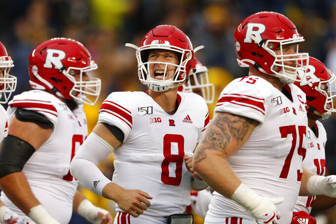 FILE - In this Sept. 28, 2019, file photo, Rutgers quarterback Artur Sitkowski (8) reacts running to the bench in the first half of an NCAA college football game against Michigan in Ann Arbor, Mich. Sitkowski and running back Raheem Blackshear took a redshirt year after coach Chris Ash was fired.  (AP Photo/Paul Sancya, FIle