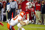 North Carolina State's Devin Leary (13) gets hit after releasing the ball by Clemson's Baylon Spector (10) during the second half of an NCAA college football game in Raleigh, N.C., Saturday, Nov. 9, 2019. (AP Photo/Karl B DeBlaker)