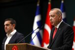 Turkey's President Recep Tayyip Erdogan, right, speaks during a news conference with Greece's Prime Minister Alexis Tsipras at the Presidential Palace in Ankara, Tuesday, Feb. 5, 2019. Tsipras and Erdogan are set to discuss an array of subjects that have strained relations between the two NATO allies, including territorial disputes in the Aegean Sea and gas exploration in the eastern Mediterranean. (AP Photo/Burhan Ozbilici)