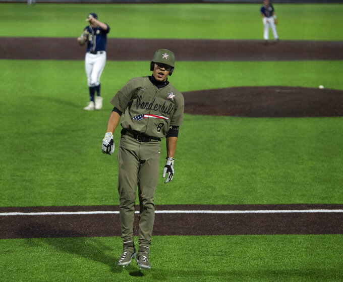Vanderbilt's Isaiah Thomas (8) skips along the first base line as he takes his bases after hitting a grand slam in the 11th inning against Georgia Tech in an NCAA Division I Baseball Regional at Hawkins Field, early Monday, June 7, 2021, in Nashville, Tenn. (George Walker IV/The Tennessean via AP)