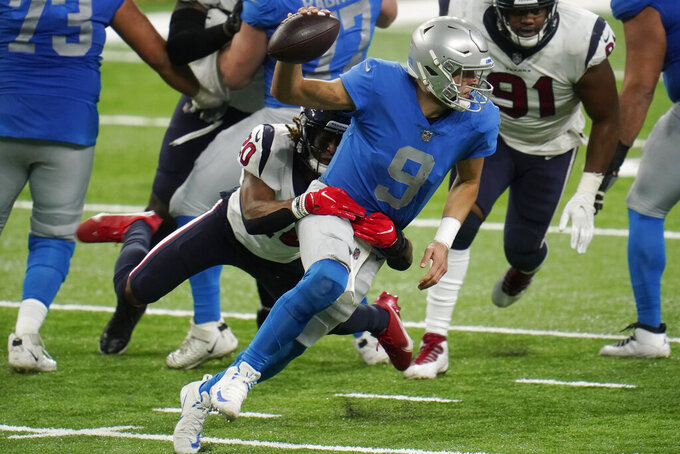 Houston Texans strong safety Justin Reid (20) sacks Detroit Lions quarterback Matthew Stafford (9) during the second half of an NFL football game, Thursday, Nov. 26, 2020, in Detroit. (AP Photo/Paul Sancya)