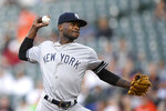 New York Yankees starting pitcher Domingo German delivers a pitch during the first inning of the team's baseball game against the Baltimore Orioles, Tuesday, May 21, 2019, in Baltimore. (AP Photo/Nick Wass)
