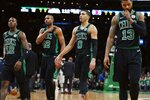 Boston Celtics' Terry Rozier (12), Al Horford (42), Jayson Tatum (0) and Marcus Morris (13) walk to the bench during a timeout in the second half of the team's NBA basketball game against the Los Angeles Clippers in Boston, Saturday, Feb. 9, 2019. (AP Photo/Michael Dwyer)