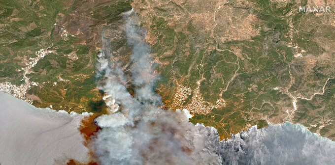 In this image provided by Maxar, a satellite view of smoke rising from wildfires near Hacibahattin on the southern coast of Turkey, on Thursday July 29, 2021.  Turkish fire crews are continuing to fight deadly blazes in southern Turkey that have burned down homes and forced many evacuations. (Satellite image ©2021 Maxar Technologies via AP)