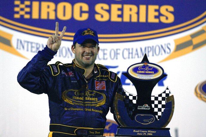 FILE - In this June 26, 2006, file photo, Tony Stewart poses with the trophy after winning the Crown Royal IROC auto race in Daytona Beach, Fla. The IROC Series, where the best drivers from various disciplines raced each other in equally prepared cars, ran for 30 seasons before Tony Stewart won its final championship in 2006 and the series quietly went away.  Now Stewart, along with fellow NASCAR Hall of Famer Ray Evernham, has teamed with a group of heavyweights to bring an all-star circuit back in 2021. The Superstar Racing Experience plans a six-race, short-track series to air in prime-time on CBS in a Saturday night summer spectacular. (AP Photo/Paul Kizzle, File)