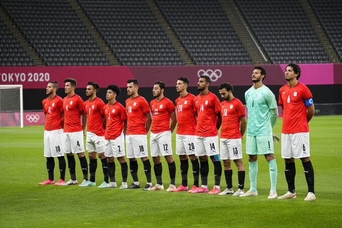 Egypt's players listen the national anthems prior to a men's soccer match against Argentina at the 2020 Summer Olympics, Sunday, July 25, 2021, in Sapporo, Japan. (AP Photo/Silvia Izquierdo)