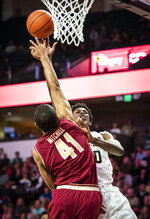 Wake Forest forward Jaylen Hoard (10) shoots over Boston College forward Steffon Mitchell (41) during an NCAA college basketball game, Saturday, Jan. 26, 2019, in Winston-Salem, N.C. (Andrew Dye/The Winston-Salem Journal via AP)