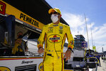 Helio Castroneves, of Brazil, looks down pit lane following practice for the Indianapolis 500 auto race at Indianapolis Motor Speedway in Indianapolis, Friday, Aug. 21, 2020. (AP Photo/Michael Conroy)