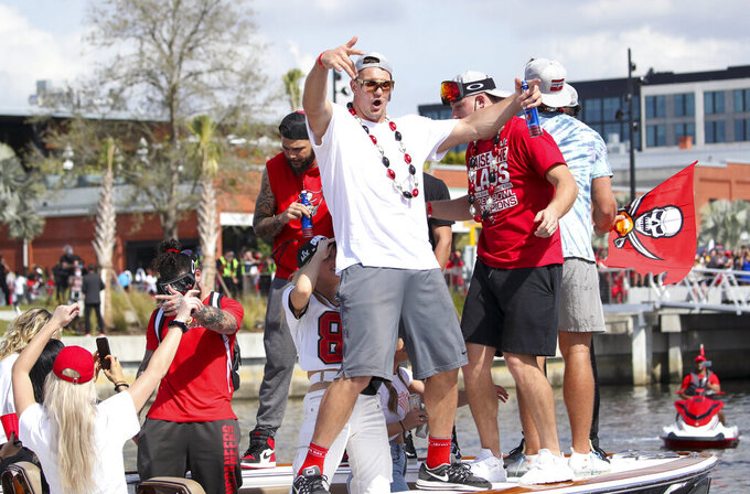 Tampa Bay Buccaneers NFL football tight end Rob Gronkowski dances as he and others celebrate their Super Bowl 55 victory over the Kansas City Chiefs with a boat parade in Tampa, Fla., Wednesday, Feb. 10, 2021. (Dirk Shadd/Tampa Bay Times via AP)