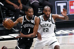 Brooklyn Nets forward Kevin Durant (7) drives to the basket past Milwaukee Bucks forward Khris Middleton during the second half of Game 1 of an NBA basketball second-round playoff series Saturday, June 5, 2021, in New York. (AP Photo/Adam Hunger)