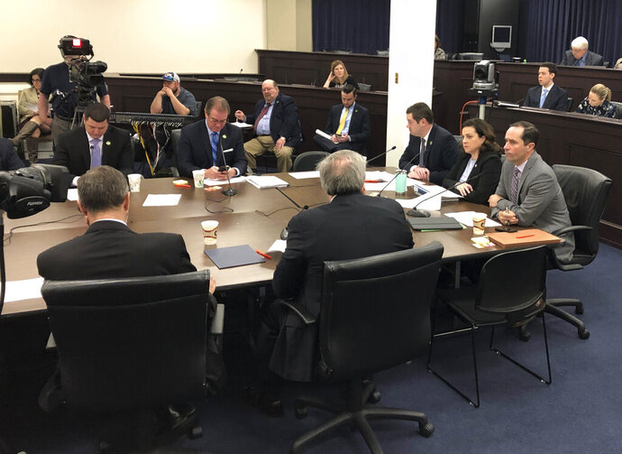 Kentucky legislative leaders discuss whether the state should borrow money on Thursday, March 14, 2019, in Frankfort, Ky. Legislative leaders later agreed to a bill that would borrow $75 million to fix up the state park system and help woo companies to locate in Kentucky.  (AP Photo/Adam Beam)