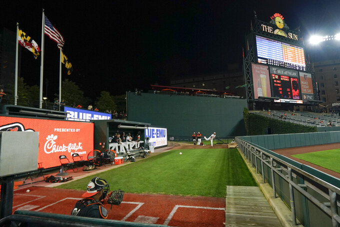 Baltimore Orioles relief pitcher Manny Barreda warms up in the bull pen during the seventh inning of baseball game against the Kansas City Royals, Wednesday, Sept. 8, 2021, in Baltimore. (AP Photo/Julio Cortez)