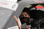 Harrison Burton looks out of his car before a NASCAR Xfinity Series auto race at Atlanta Motor Speedway, Saturday, June 6, 2020, in Hampton, Ga. (AP Photo/Brynn Anderson)