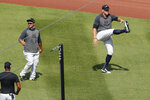 New York Yankees Mike Ford looks for the next instruction as New York Yankees right fielder Aaron Judge stretches during baseball practice Sunday, July 5, 2020, at Yankee Stadium in New York. (AP Photo/Kathy Willens)