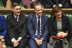 Lawmakers react during a debate on an early election, with members of the ruling Conservative Party, from left, Jacob Rees-Mogg, Dominic Raab, Nicky Morgan, in the House of Commons, London, Monday Oct. 28, 2019.  Lawmakers on Monday rejected Johnson's call for a December national election, in the hope of breaking the political deadlock over Brexit. (Jessica Taylor/House of Commons via AP)