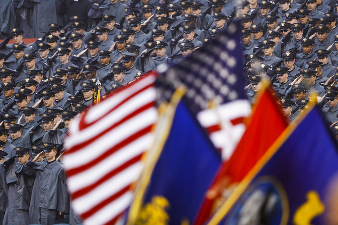 Army cadets salute ahead of an NCAA college football game against Navy, Saturday, Dec. 14, 2019, in Philadelphia. (AP Photo/Matt Slocum)