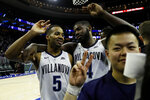 Villanova's Phil Booth, left, and Eric Paschall celebrate after an NCAA college basketball game against Butler, Saturday, March 2, 2019, in Philadelphia. Villanova won 75-54. (AP Photo/Matt Slocum)