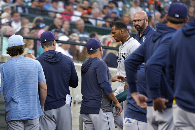 Tampa Bay Rays' Wander Franco walks to the locker room past teammates after being removed from the game against the Detroit Tigers in the first inning of a baseball game in Detroit, Friday, Sept. 10, 2021. (AP Photo/Paul Sancya)