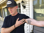 Brendan Kelly speaks with reporters outside his home, as he shows his Route 91 tattoo, Thursday, Nov. 8, 2018, in Thousand Oaks, Calif. Kelly, a Marine who was at Borderline Bar and Grill on Wednesday night, helped people get out after a gunman opened fire at the establishment. Kelly also survived the Las Vegas Route 91 Harvest Festival shooting in 2017. (AP Photo/Ryan Pearson)
