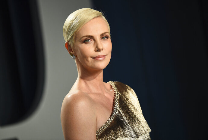 FILE - This Feb. 9, 2020 file photo shows actress Charlize Theron at the Vanity Fair Oscar Party in Beverly Hills, Calif. Theron stars and produces the Netflix action thriller