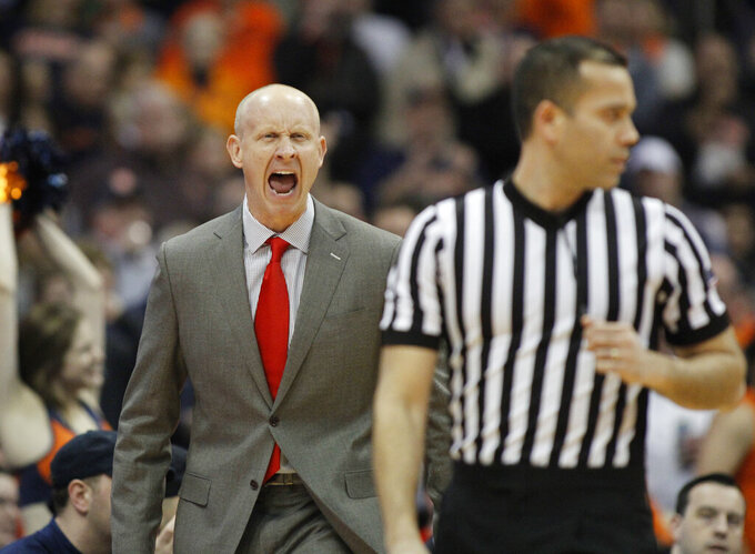 Louisville head coach Chris Mack yells to an official during the second half of an NCAA college basketball game against Syracuse in Syracuse, N.Y., Wednesday, Feb. 20, 2019. Syracuse won 69-49. (AP Photo/Nick Lisi)