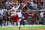 Minnesota defensive back Tyler Nubin, right, intercepts a pass intended for Miami-Ohio wide receiver Austin Robinson during the second half of an NCAA college football game on Saturday, Sept. 11, 2021, in Minneapolis. Minnesota won 31-26. (AP Photo/Craig Lassig)