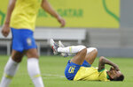 Brazil's Neymar lies on the pitch after being fouled during a friendly match against Qatar in Brasilia, Brazil, Wednesday, June 5, 2019. Brazil and Qatar are preparing for the Copa America which runs from June 14 until July 7 in Brazil. (AP Photo/Andre Penner)
