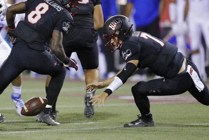 UNLV Rebels quarterback Kenyon Oblad tries to recover a fumble during the first half of an NCAA college football game against Boise State, Saturday, Oct. 5, 2019, in Las Vegas. (AP Photo/John Locher)