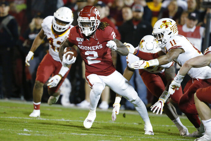 FILE - In this Nov. 9, 2019, file photo, Oklahoma wide receiver CeeDee Lamb (2) carries during the team's NCAA college football game against Iowa State in Norman, Okla. The Raiders have the 12th and 19th picks in the NFL draft thanks to the 2018 trade that sent star pass rusher Khalil Mack to the Chicago Bears. Several receivers are projected to go in the first round. Alabama's Jerry Jeudy and Henry Ruggs and Oklahoma's Lamb are considered by many analysts to be the best of the bunch. (AP Photo/Sue Ogrocki, File)
