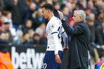 Tottenham's manager Jose Mourinho, right, accompanies Tottenham's Dele Alli as he leaves the field during the English Premier League soccer match between West Ham and Tottenham, at London stadium, in London, Saturday, Nov. 23, 2019.(AP Photo/Frank Augstein)