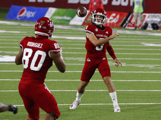 Fresno State quarterback Jake Haener completes a pass to Juan Rodriguez against Hawaii during the second half of an NCAA college football game in Fresno, Calif., Saturday, Oct. 24, 2020. (AP Photo/Gary Kazanjian)