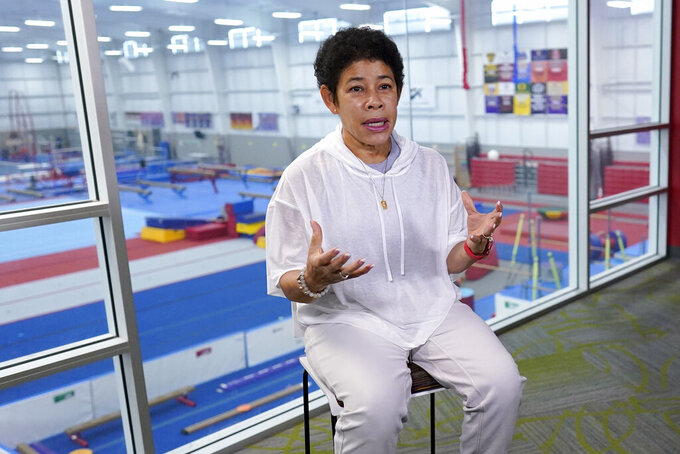 Nellie Biles, mother of reigning Olympic champion gymnast Simone Biles, talks about her gym during an interview Tuesday, May 11, 2021, in Spring, Texas. (AP Photo/David J. Phillip)