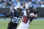 Atlanta Falcons wide receiver Calvin Ridley (18) catches a pass while Carolina Panthers cornerback Donte Jackson (26) defends during the second half of an NFL football game in Charlotte, N.C., Sunday, Nov. 17, 2019. (AP Photo/Mike McCarn)