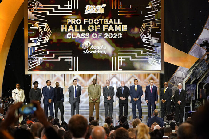 Hall of Fame Class of 2020, stand on stage at the NFL Honors football award show Saturday, Feb. 1, 2020, in Miami. (AP Photo/David J. Phillip)