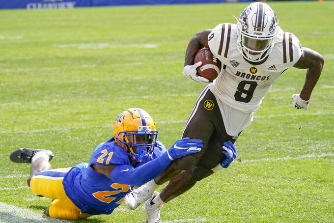 Pittsburgh defensive back Damarri Mathis (21) is dragged by Western Michigan running back Sean Tyler (9) as he runs the ball during the second half of an NCAA college football game, Saturday, Sept. 18, 2021, in Pittsburgh. Western Michigan won 44-41. (AP Photo/Keith Srakocic)